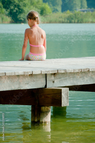 Little Girl On Pier