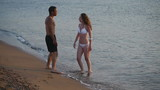 HD720p25 Happy young couple playing on the beach. Slow Motion