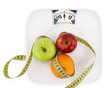 Diet concept. Fruits with measuring tape  on a plate