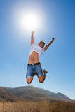 Happy young man jump in the mountains