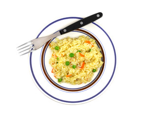 Rice pilaf in dish on white background