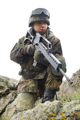 Soldier with automatic gun covering