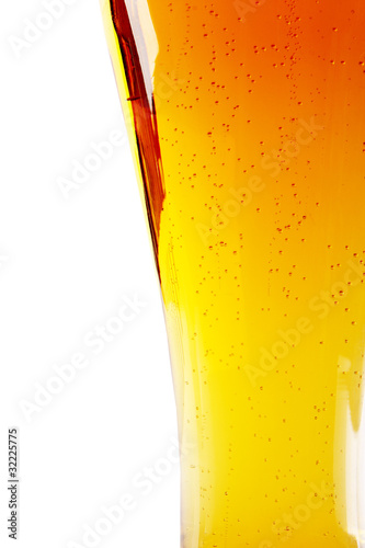 Detail of glass of beer, isolated on white background