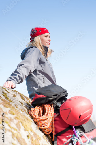 Active woman rock climbing relax with backpack