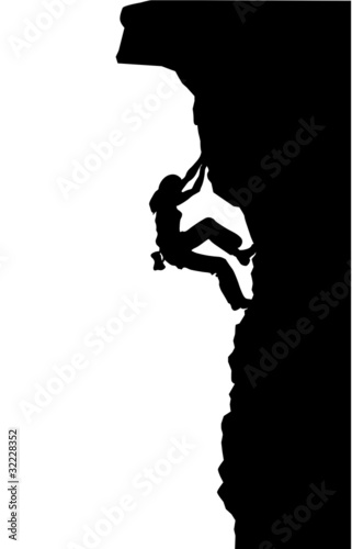 Silhouette of a woman climbing