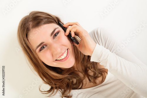 Smiling young woman with phone
