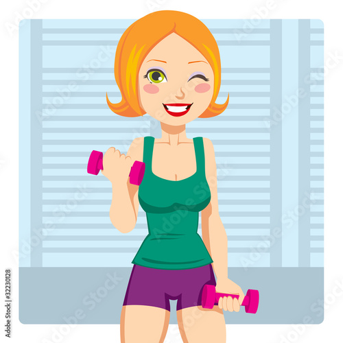 Beautiful red hair girl exercising with two dumbbell weights