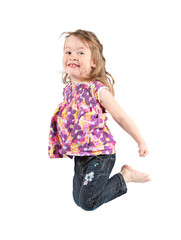Adorable little girl jumping in air.