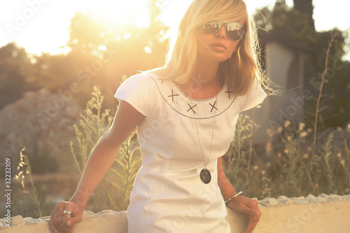 Beautiful blonde woman in sunny day