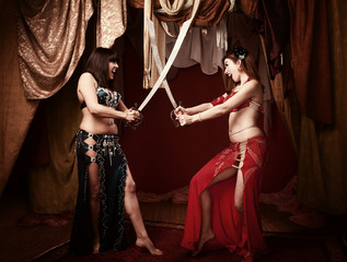 Beautiful Belly Dancers With Swords