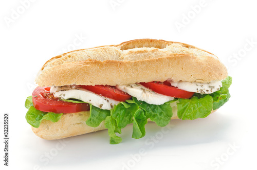 Fotobehang Picknick Panino con mozzarella, insalata e pomodoro