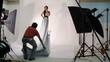 model in long dress pose for photographer in studio, time lapse