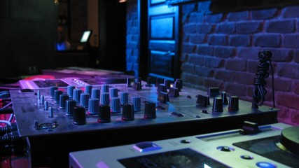 DJ panel during wedding party in nightclub