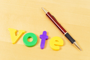Vote Spelled Out with Pen on Table