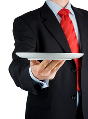Businessman offering empty plate