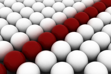 red spheres among white similar ones