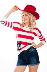 Sexy american-dressed girl wearing red hat