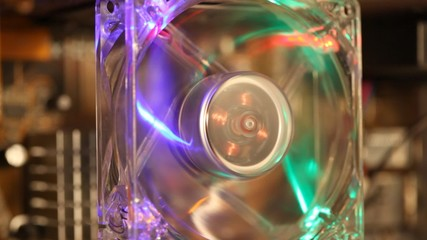 computer fan with LED illumination, wires on background
