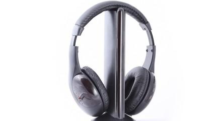 black headphones rotating on white background