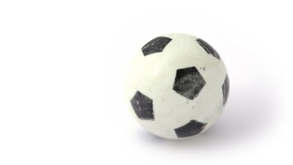 small toy soccer ball rotating on white