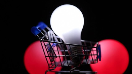 electric lamp in toy shopping trolley, color lights