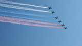 planes in sky leaving trail of smoke as tricolor Russian flag