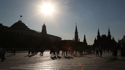 Red Square view from brick ground with tourists walking around