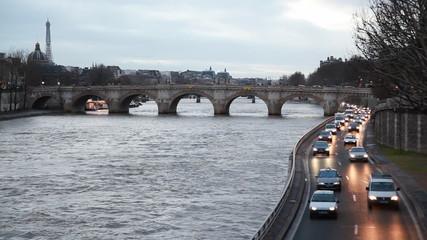River Seine, bridge on left see Eiffel Tower, right move cars