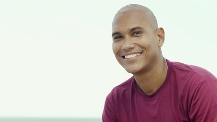 young latino man smiling at camera