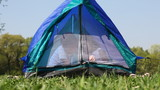boy and girl close zipper mosquito net sitting inside tent