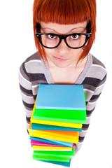 schoolgirl holding pile books