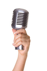 Retro styled microphone in hand isolated