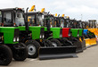 View of brand new tractors in a line