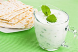 Fresh Greek Tzatziki dip with cucumber and matzo bread