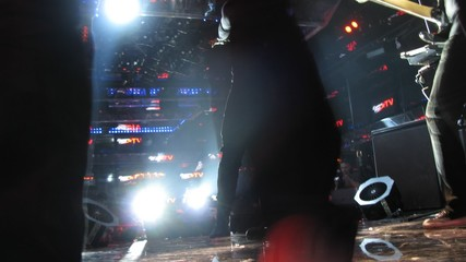 View from stage on singer who performs in nightclub, time lapse