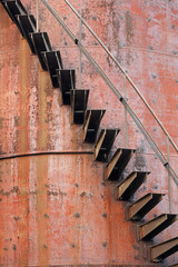 stairs with guard rail on a rusted industrial structure