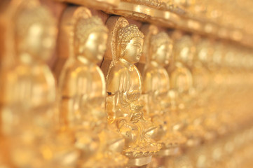A lot of chinese buddhas statue full frame.