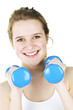 Happy active girl exercising with weights