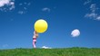 girl stands with yellow bubble on green grass meadow
