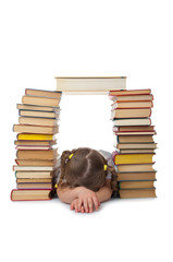 Sleeping little girl with books