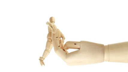 rotation of wooden toy giant arm with little toy man outside