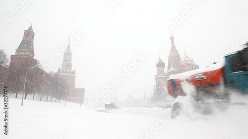units move near Moscow Kremlin, remove snowfall with plows