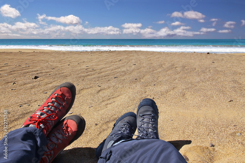 Relaxing on the beach after a long hiking tour