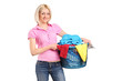 Young woman carrying a laundry basket