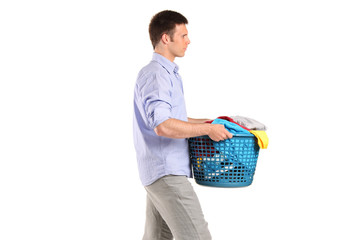 Young man carrying a laundry basket