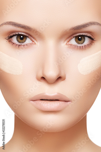 Skin care & cosmetics. Woman applying skin tone foundation