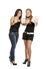 portrait of two young girls in full-length