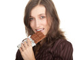 portrait of smiling young woman holding chocolate