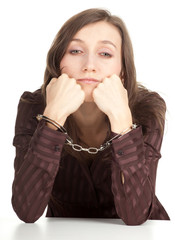 sitting young woman with handcuffed hands