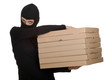 female thief in balaclava with boxes of pizza